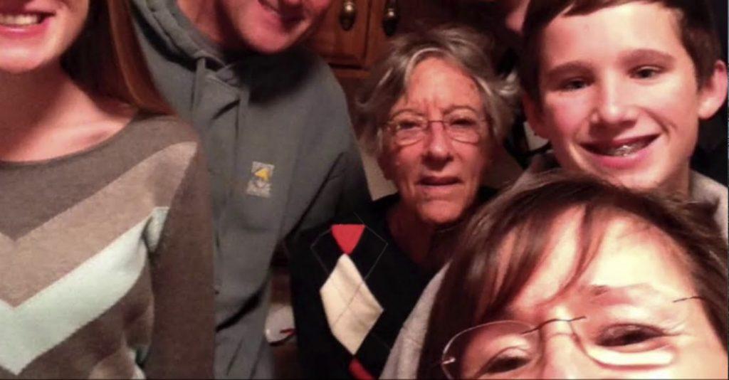 Charter Senior Living of Gainesville Video Thumbnail Family Group Surrounded by senior living resident